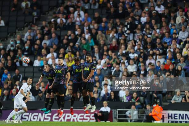 Oliver Skipp, Matt Doherty, Dele Alli and Cameron Carter-Vickers of Tottenham form a defensive wall in front of a crowd at Stadium MK during the...
