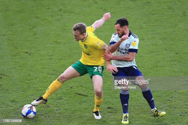 Oliver Skipp of Norwich City and Greg Cunningham of Cardiff City battle for possession during the Sky Bet Championship match between Norwich City and...