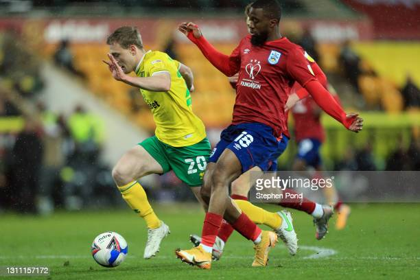 Oliver Skipp of Norwich City is fouled for a penalty by Isaac Mbenza of Huddersfield Town during the Sky Bet Championship match between Norwich City...