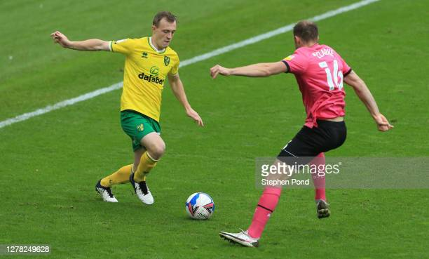 Oliver Skipp of Norwich City is put under pressure by Matthew Clarke of Derby County during the Sky Bet Championship match between Norwich City and...
