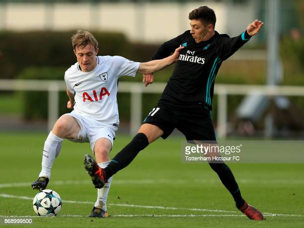 Oliver Skipp of Tottenham Hotspur and Cesar Gelabert Pina of Real Madrid compete for the ball during the UEFA Youth League group H match between...
