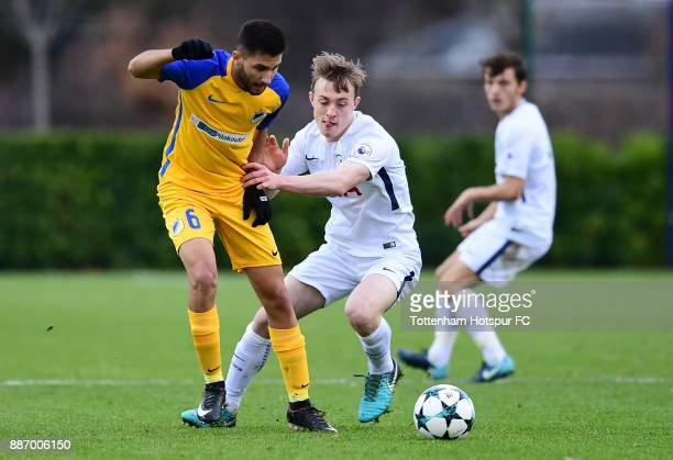 Oliver Skipp of Tottenham Hotspur and Marcos Stylianides of APOEL Nicosia contest the ball during the UEFA Youth League group H match between...