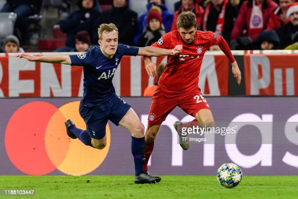 Oliver Skipp of Tottenham Hotspur and Thomas Mueller of FC Bayen Muenchen battle for the ball during the UEFA Champions League group B match between...