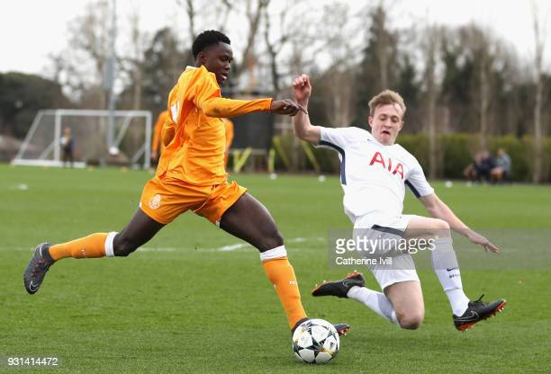 Oliver Skipp of Tottenham Hotspur closes down Madi Queta of FC Porto during the UEFA Youth League group H match between Tottenham Hotspur and FC...