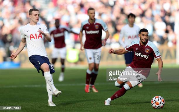 Oliver Skipp of Tottenham Hotspur in action with Said Benrahma of West Ham United during the Premier League match between West Ham United and...