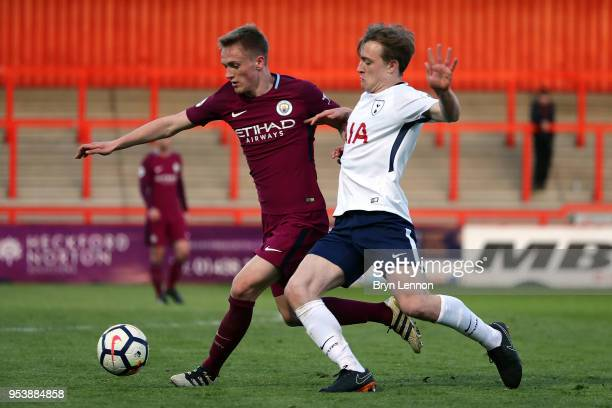 Oliver Skipp of Tottenham Hotspur is tackled by Matt Smith of Manchester City during the Premier League 2 match between Tottenham Hotspur and...