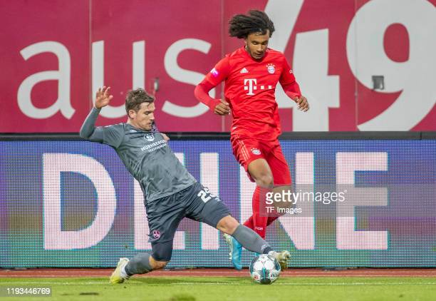 Oliver Sorg of 1FC Nuernberg and Joshua Zirkzee of FC Bayern Muenchen battle for the ball during a friendly match between 1 FC Nuernberg and FC...