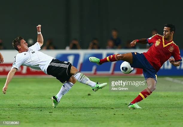 Oliver Sorg of Germany is challenged by Thiago Alcantara of Spain during the UEFA European U21 Champiosnship Group B match between Germany and Spain...