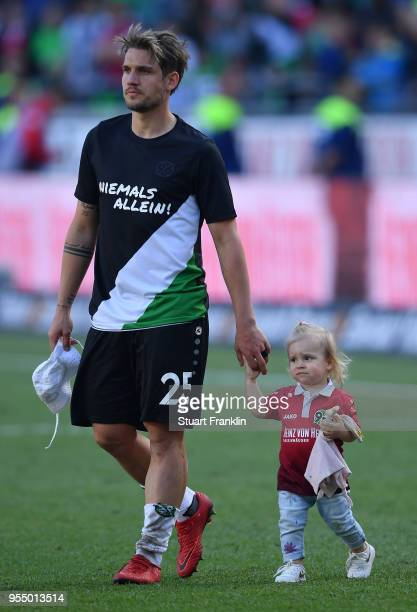 Oliver Sorg of Hannover and child after the Bundesliga match between Hannover 96 and Hertha BSC at HDIArena on May 5 2018 in Hanover Germany