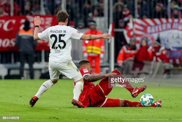 Oliver Sorg of Hannover and Jerome Boateng of Bayern Muenchen battle for the ball during the Bundesliga match between FC Bayern Muenchen and Hannover...