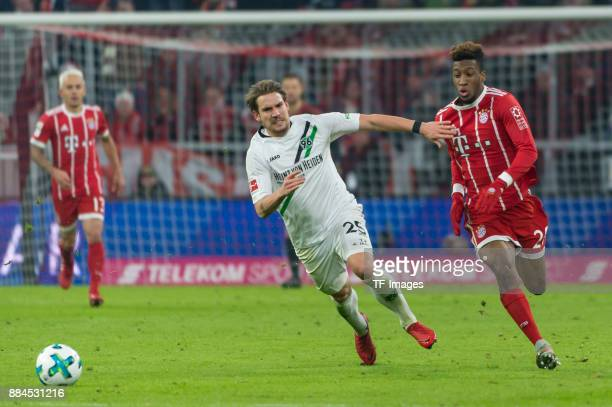 Oliver Sorg of Hannover and Kingsley Coman of Bayern Muenchen battle for the ball during the Bundesliga match between FC Bayern Muenchen and Hannover...