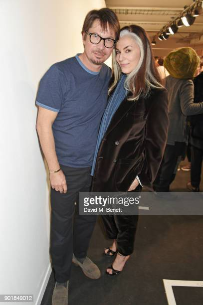 Oliver Spencer and Catherine Hayward pose backstage at the Oliver Spencer LFWM AW18 Catwalk Show at the BFC Show Space on January 6 2018 in London...