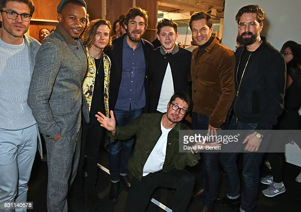 Oliver Spencer poses with Darren Kennedy Eric Underwood Dougie Poynter Robert Konjic Niall Horan Paul Sculfor and Jack Guinness backstage at the...