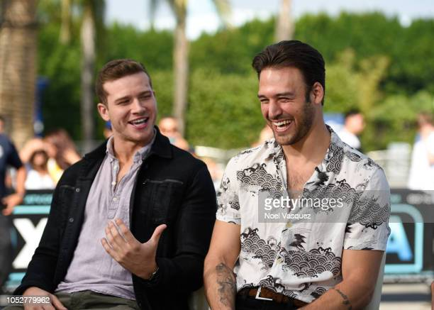 """Oliver Stark and Ryan Guzman visit """"Extra"""" at Universal Studios Hollywood on October 22, 2018 in Universal City, California."""