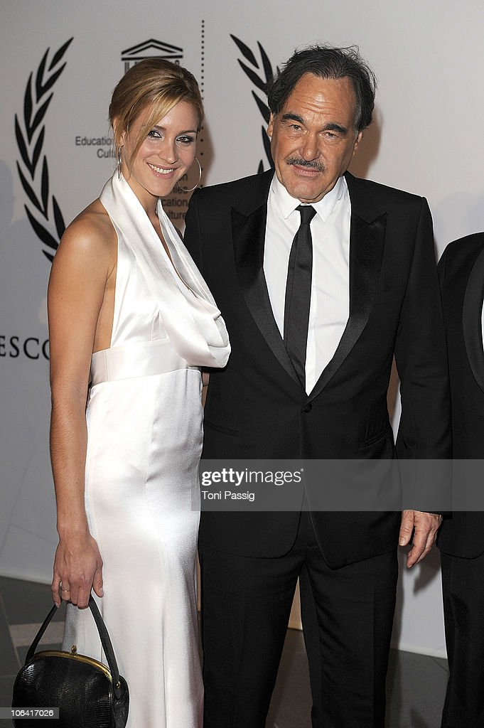 Oliver Stone and Florine Elena Deplazes attend the UNESCO Charity-Gala 2010 at Maritim Hotel on October 30, 2010 in Duesseldorf, Germany.
