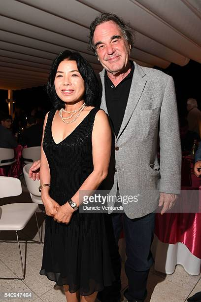 Oliver Stone and Sunjung Jung attend Baume Mercier 62 Taormina Film Fest Gala Dinner on June 17 2016 in Taormina Italy