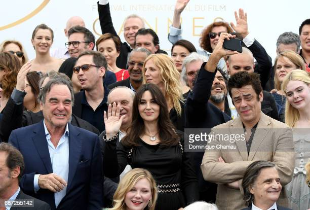 Oliver Stone Monica Bellucci Benicio del Toro and Elle Fanning and Kirsten Dunst attends the 70th Anniversary photocall during the 70th annual Cannes...