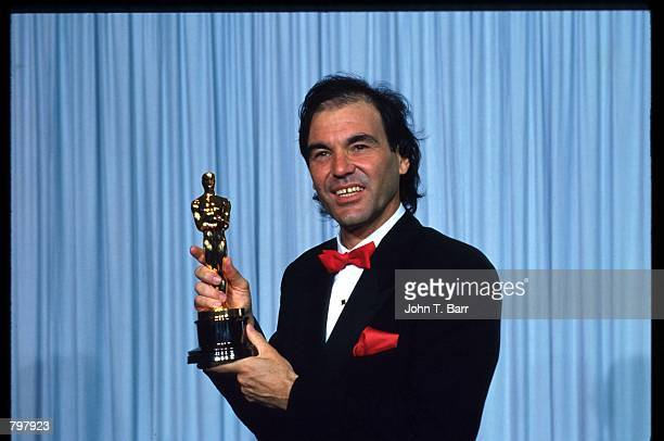 Oliver Stone stands backstage during the 62nd Academy Awards ceremony March 26 1990 in Los Angeles CA Stone received an Oscar for Best Director for...