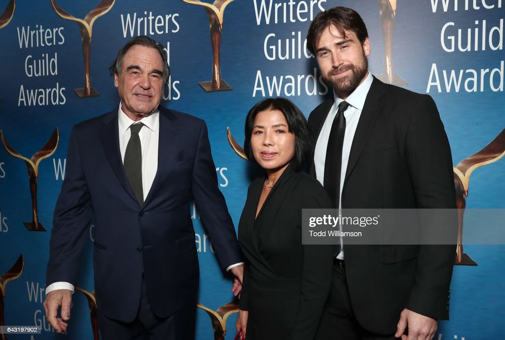 Oliver Stone, Sun-jung Jung and Sean Stone attend the 2017 Writers Guild Awards L.A. Ceremony at The Beverly Hilton Hotel on February 19, 2017 in Beverly Hills, California.