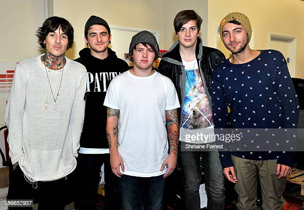 Oliver Sykes Lee Malia Matt Kean Matt Nicholls and Jordan Fish of Bring Me The Horizon pose before meeting fans and signing copies of a new HMV...