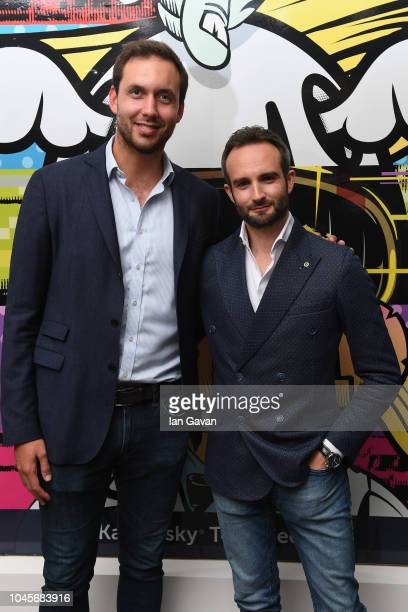 Oliver Tennant of Virgin Racing and Andrea Ferrero of Kaspersky Lab attend the unveiling of the firstever Formula art car by Kaspersky Lab and street...