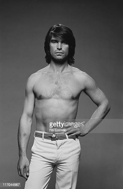 Oliver Tobias Swissborn actor poses barechested for a studio portrait circa 1980