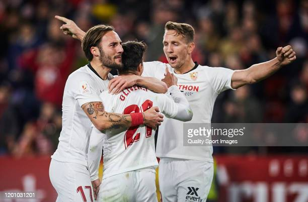 Oliver Torres Muñoz of Sevilla FC celebrates scoring his team's third goal with team mates during the Copa del Rey match between Sevilla FC and...