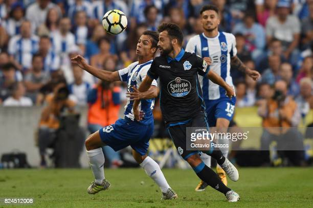 Oliver Torres of FC Porto competes for the ball with Bruno Gama of RC Deportivo La Coruna during the PreSeason Friendly match between FC Porto and RC...