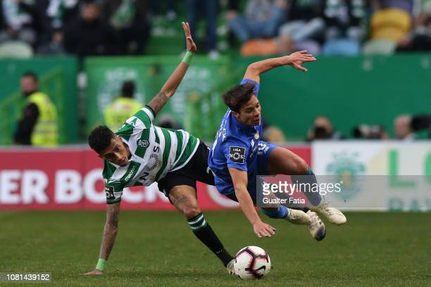 Oliver Torres of FC Porto tackled by Raphinha of Sporting CP during the Liga NOS match between Sporting CP and FC Porto at Estadio Jose Alvalade on...