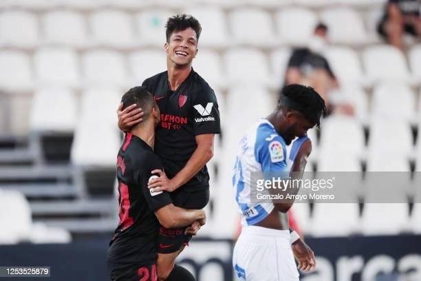 Oliver Torres of Sevilla celebrates with teammate Joan Jordan of Sevilla after scoring his team's second goal during the Liga match between CD...