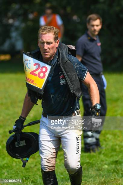 Oliver Townend of England riding Ballaghmor Class takes a fall wearing an airbag jacket during the obstacle in the water of the Cross Country test...