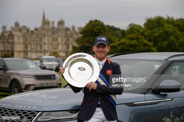 Oliver Townend of Great Britain poses for the camera's with the trophy after he wins The Land Rover Burghley Horse Trials 2017 on September 3 2017 in...