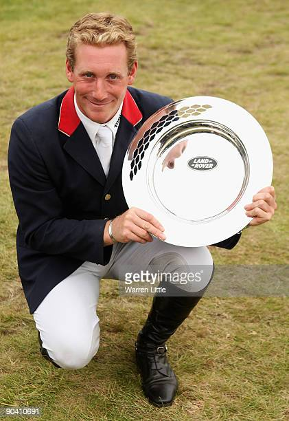Oliver Townend of Great Britain poses with the trophy after winning the Land Rover Burghley Horse Trials on September 6 2009 in Stamford United...