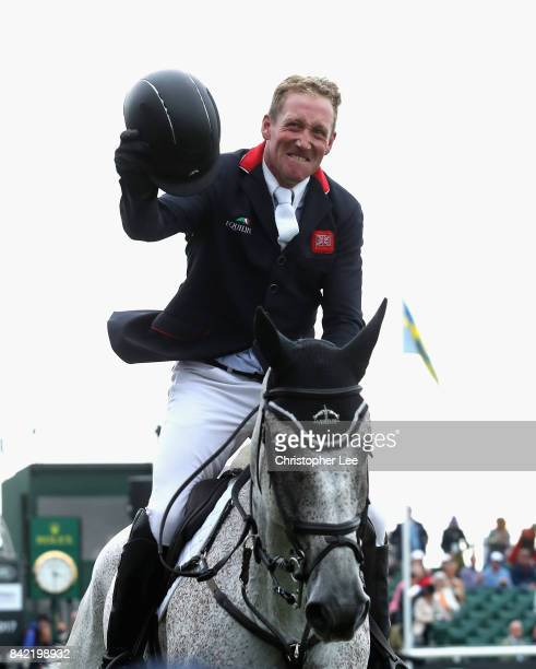 Oliver Townend of Great Britain riding Ballaghmor Class celebrates winning the Land Rover Burghley Trophy during Day Four of The Land Rover Burghley...