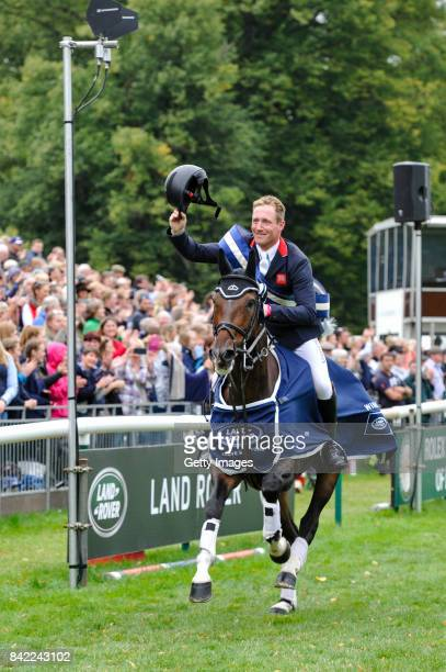 Oliver Townend of Great Britain riding Samuel Thomas II in his lap of Honour after he wins The Land Rover Burghley Horse Trials 2017 riding...