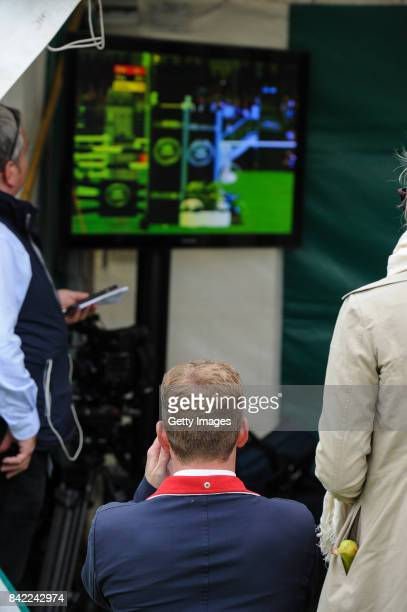 Oliver Townend of Great Britain watches his compeitors in the show jumping before he takes part in The Land Rover Burghley Horse Trials 2017 on...