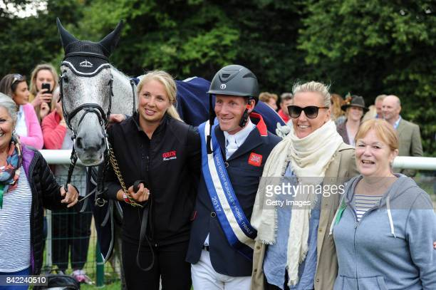 Oliver Townend of Great Britain with his horse Ballaghmor Class and the horse owners during Day Four of The Land Rover Burghley Horse Trials 2017 on...