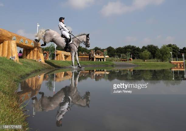 Oliver Townend of Team Great Britain riding Ballaghmor Class clears a jump during the Eventing Cross Country Team and Individual on day nine of the...