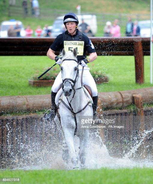Oliver Townend riding Flint Curtis goes through the water during the cross country course at Bramham International Horse Trials Bramham Leeds