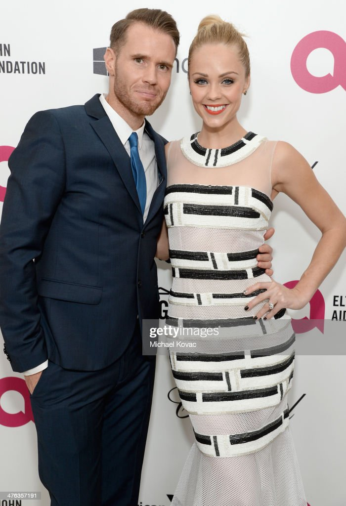 Oliver Trevena (L) actress Laura Vandervoort attend the 22nd Annual Elton John AIDS Foundation Academy Awards Viewing Party at The City of West Hollywood Park on March 2, 2014 in West Hollywood, California.