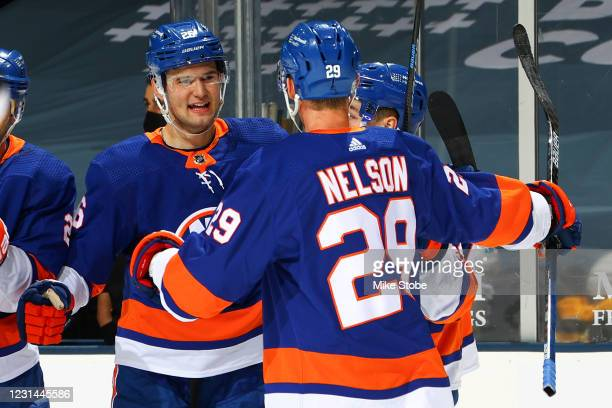 Oliver Wahlstrom of the New York Islanders is congratulated by Brock Nelson after scoring a goal against the Pittsburgh Penguins during the first...