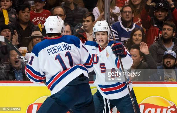 Oliver Wahlstrom of the United States celebrates with Ryan Poehling after scoring a goal against Russia in Semifinals hockey action of the 2019 IIHF...