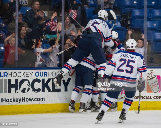 Oliver Wahlstrom of the USA Nationals celebrates a third period game tying goal with teammates Jack Hughes Adam Samuelsson and Spencer Stastney...