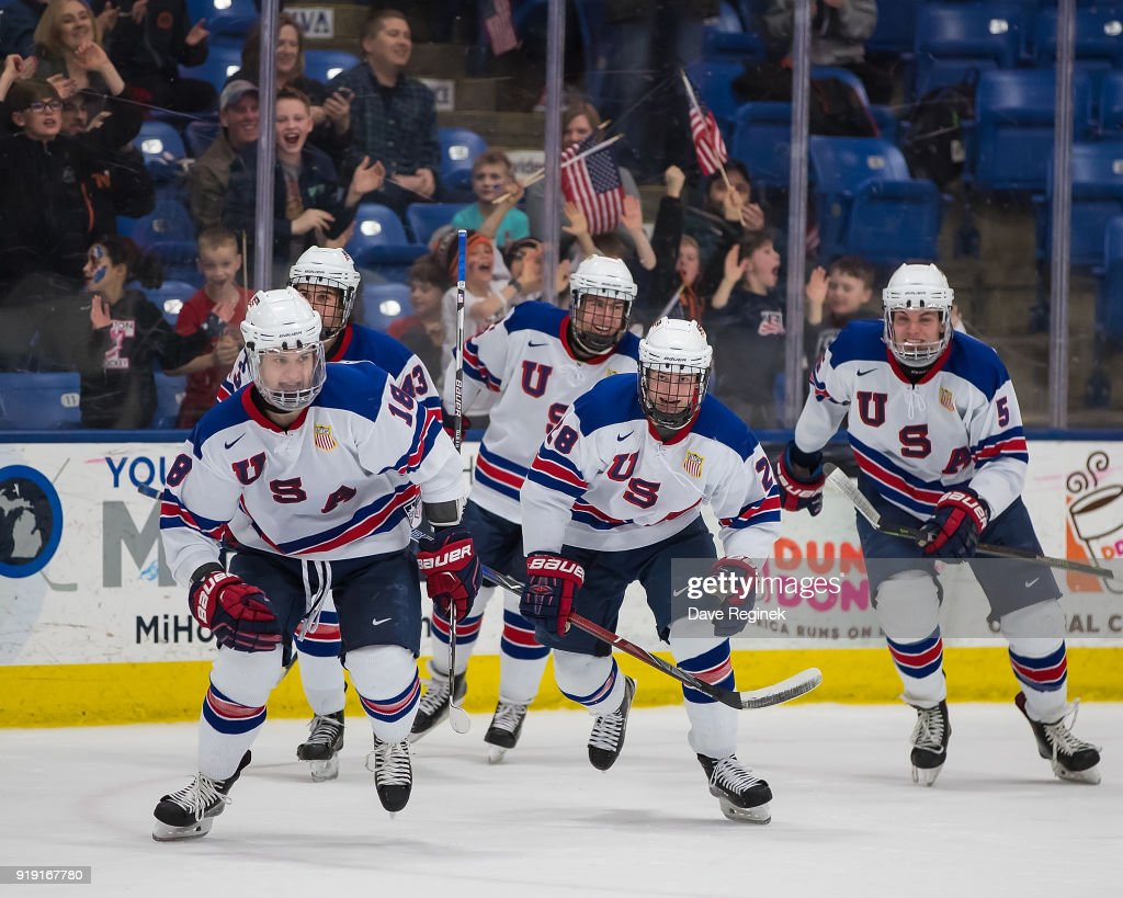 Oliver Wahlstrom #18 of the USA Nationals celebrates a third period, game tying goal with teammates Jack Hughes #43, Adam Samuelsson #5, Joel Farabee #28 and Spencer Stastney #25 against the Russian Nationals during the 2018 Under-18 Five Nations Tournament game at USA Hockey Arena on February 16, 2018 in Plymouth, Michigan.