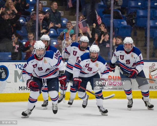Oliver Wahlstrom of the USA Nationals celebrates a third period, game tying goal with teammates Jack Hughes, Adam Samuelsson, Joel Farabee and...