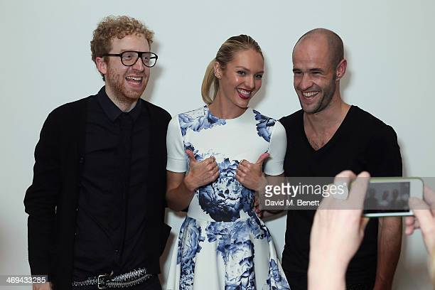 Oliver Wayman Candice Swanepoel and Cameron Saul attend the Narcisco Rodriguez Bottletop launch party at Victoria Miro Gallery on February 14 2014 in...