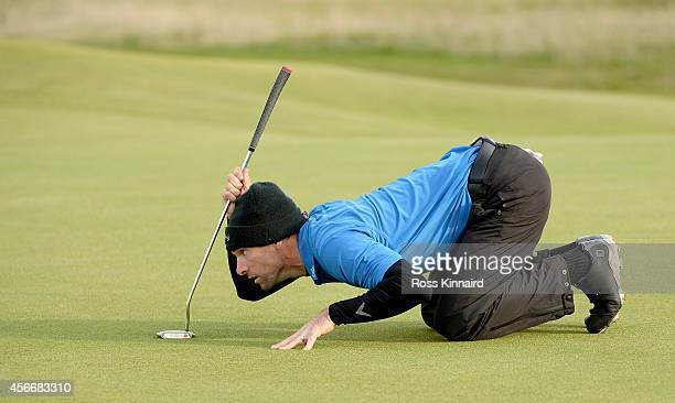 Oliver Wilson of England lines up his birdie putt on the 16th green during the final round of the 2014 Alfred Dunhill Links Championship at The Old...