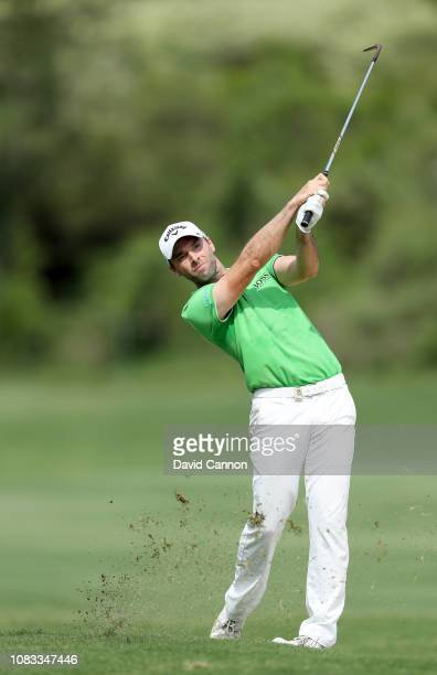 Oliver Wilson of England plays his second shot on the par 4 17th hole during the final round of the Alfred Dunhill Championships at Leopard Creek...
