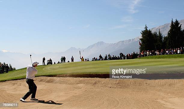 Oliver Wilson of England plays his second shot on the par three 8th hole during the third round of the Omega European Masters at the Crans-Sur-Sierre...
