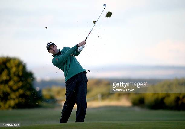 Oliver Wilson of England plays his second shot to the 17th hole during the third round of the 2014 Alfred Dunhill Links Championship at The Old...
